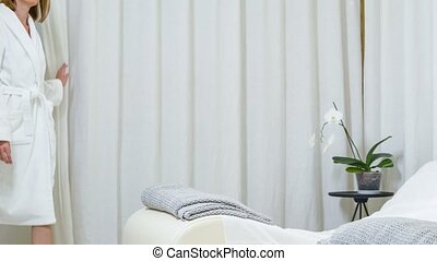 Calm lady having rest after treatment in beauty salon -...