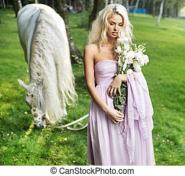 Calm lady with horse and bouquet of flowers