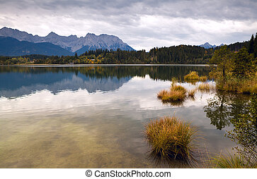 calm landscape with wild lake and mountains
