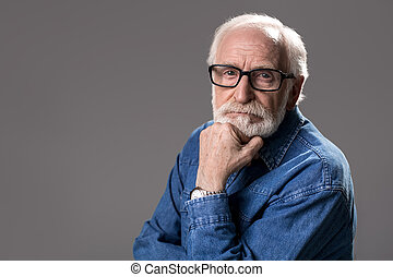 Calm male pensioner wearing glasses - Portrait of grizzled...