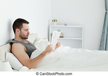 Calm man reading a newspaper