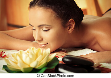 calm mood - Beautiful young woman taking spa treatments at...
