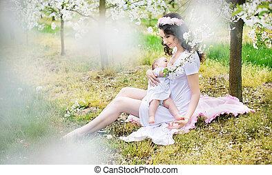 Calm mother feeding her beloved child