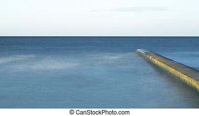 Calm Ocean with Breakwater Structure