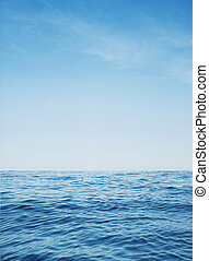 Calm ocean with clear blue water