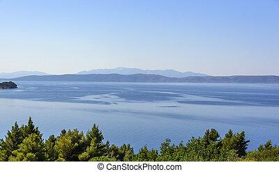 Calm on the sea. Seascape with a ridge on a horizon.
