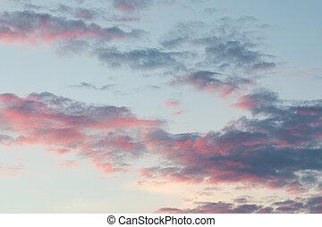 Calm pink clouds sky cloudscape at dusk