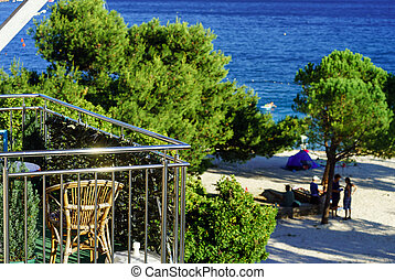Calm place, balcony with chair over the beach