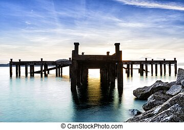 Calm scene detail of old jetty at twilight