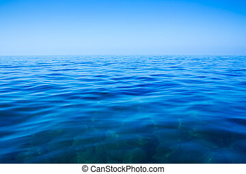 Calm sea and blue clear sky in summer day