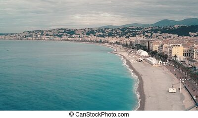 Calm sea and panorama of Nice, France, on a warm spring day