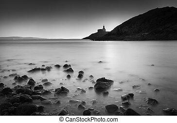 Calm sea at Mumbles lighthouse