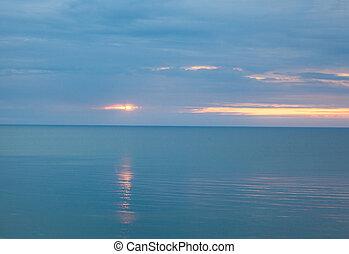 Calm sea in a cloudy morning