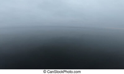 Calm sea landscape. Horizon skyline, sea reflective surface in quiet calm cloudy overcast weather. Smooth surface gray color. Natural ocean backdrop fall autumn spring concept close-up