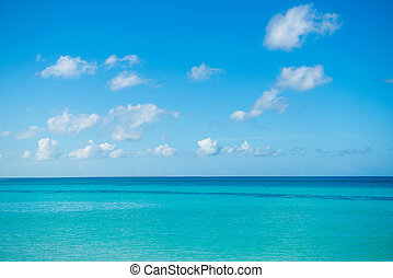 Calm sea, ocean and blue cloudy sky. Horizon. Picturesque Seascape