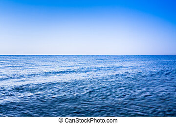 Calm sea ocean and blue clear sky