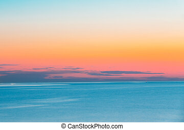 Calm Sea Or Ocean And Colorful Sunset Or Sunrise Sky Background.