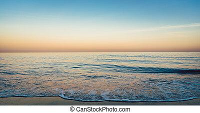 Calm sea or ocean at dusk
