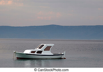 calm sea -  boat on calm sea