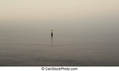 Calm sea with buoy - Calm sea with small ripples and buoy...