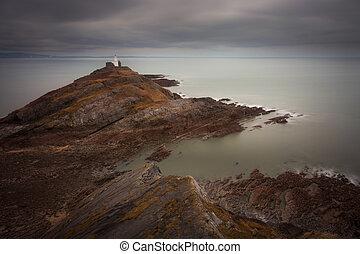 Calm seas at Mumbles lighthouse