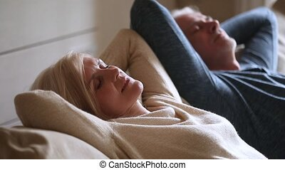 Calm senior middle aged couple relaxing leaning on...