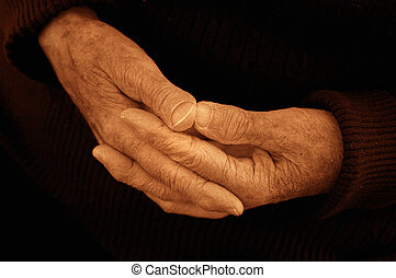 The hands of an 80 year old woman.