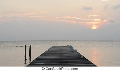Calm Sunrise Over Jetty - Calm scenic of slow sunrise over...