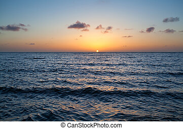 calm sunset over North sea - calm sunset overwaves on North...