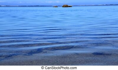 Calm tropical lagoon - Blue tranquil waters of a tropical...