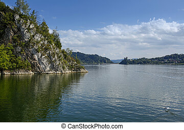 calm waters of the Czorsztyn Lake and the Niedzica Castle in...