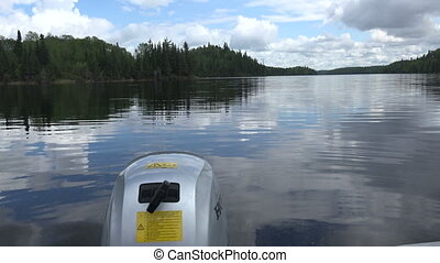 Calm Waters Reflection From Boat - A 4k clip from Red Lake,...