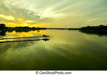 Calm Waters Sunset. Calm Waters of the Lake During Spring...