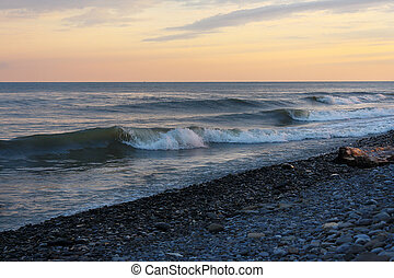 Calm waves on beach in the evening