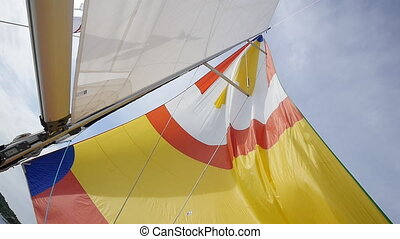 Calm wind blows in colorful sail on background of sky on the island of Crete.