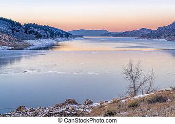calm winter dusk over mountain lake
