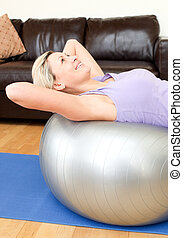 Calm woman doing exercice at home