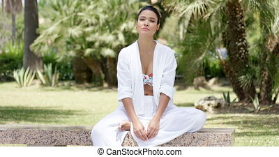 Calm woman sitting by herself on granite bench - Beautiful...