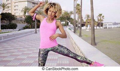 Calm woman stretching at beach resort - Single beautiful...