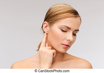 calm woman touching her ear - health and beauty concept - ...