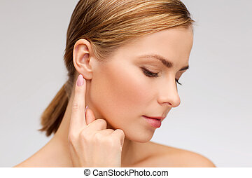 calm woman touching her ear - health and beauty concept -...