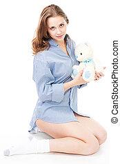 Calm woman with teddy bear
