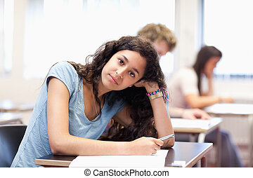 Calm young student posing