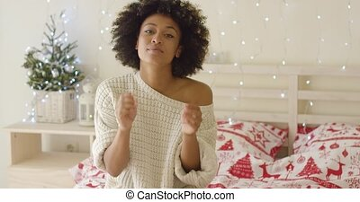 Calm young woman adusting hair in bed - Beautiful young...