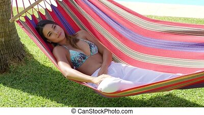 Calm young woman in hammock