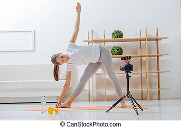 Calm young woman practicing yoga and feeling relaxed