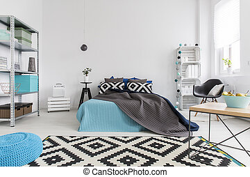 Calming and soothing colour palette - Shot of a bed in a ...