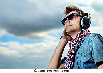 calmness - Portrait of a handsome young man in headphones...