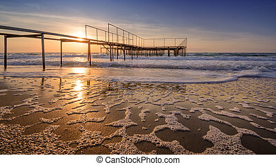 Calmness - Sunrise on old ocean pier - sea waves unusual...