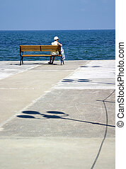 Calmness - The woman looking at the sea